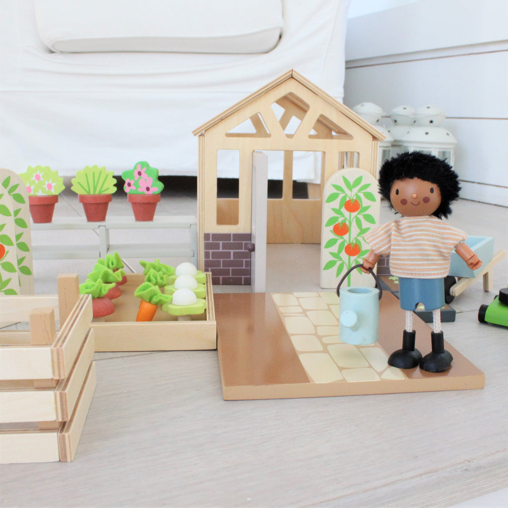 tender leaf toys wood greenhouse garden set for children dolls house extension pack with vegetable patch flowers lawnmower watering can seed tray and an opening door. a perfect addition to your dollies.