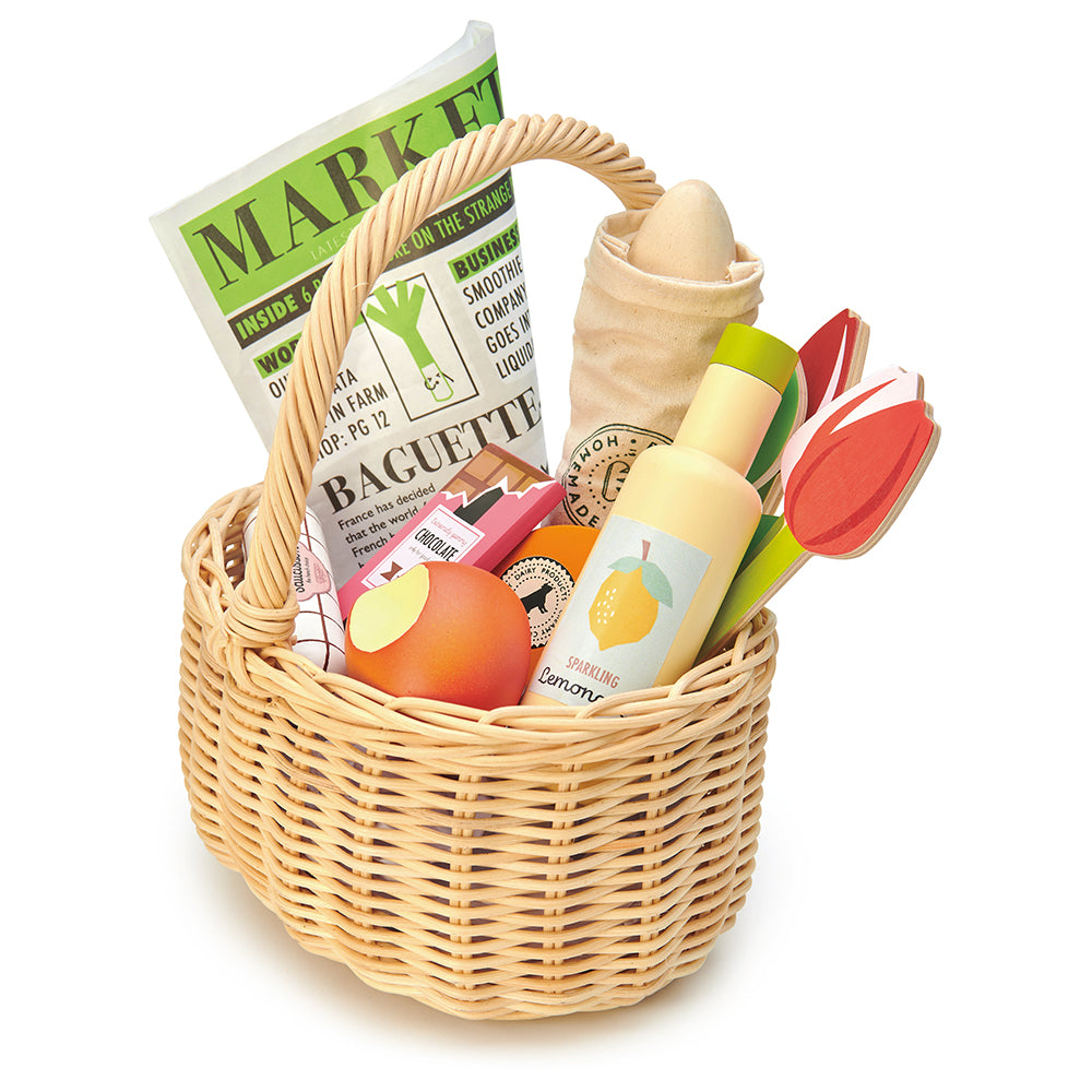 Tender Leaf wooden shopping wicker basket pretend play food set for children with newspaper, apple, lemonade chocolate flowers tulips and some cheese
