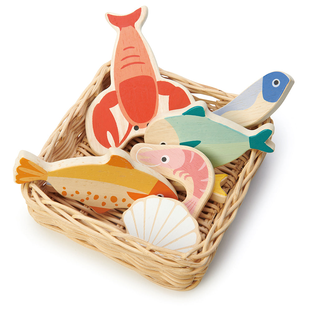 A hand crafted wicker basket with plastic free wooden lobster, plaice, mackerel, herring, whitebait, prawn and scallop.  Part of our Market day Range and an accessory to our gorgeous Farmers Market.