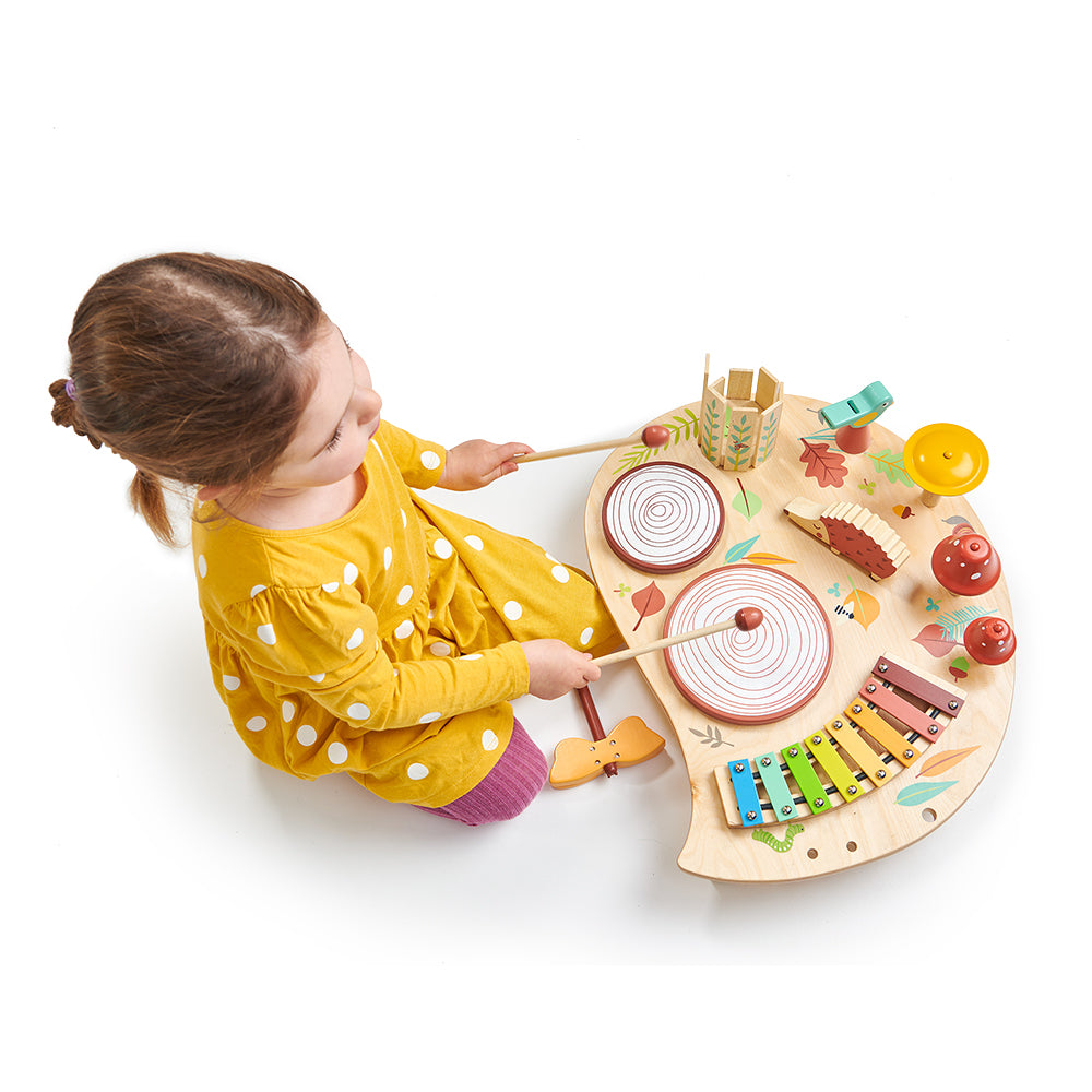 Tenderleaf wooden music tray table for children with drums bells and lots of accessories. Woodland rainbow theme