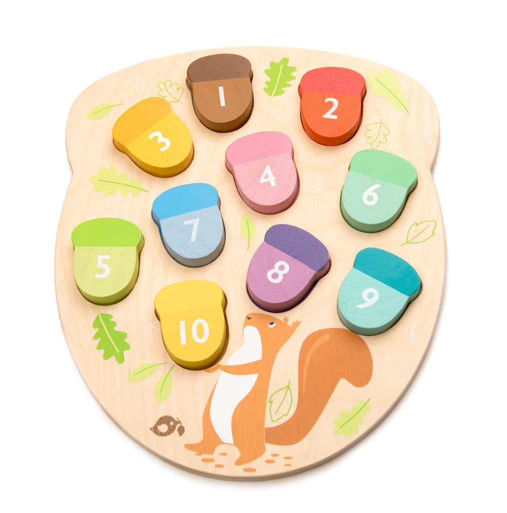 Tender Leaf Toys wooden counting game to educate toddlers. 10 numbered acorn puzzle pieces designed for child development and learning through play