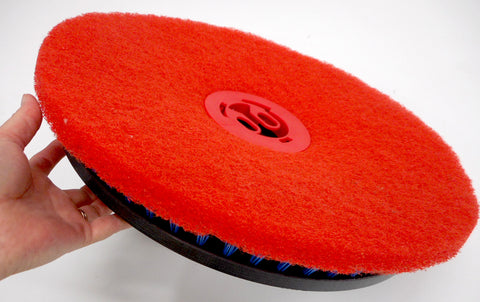 Universal red pad clip holding on a pad to pad driver