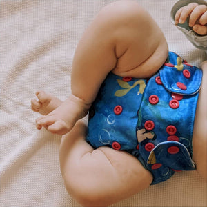 Child wearing CrackaDaks all-in-two / pocket cloth nappy - Siren's Song - Peanut and Poppet UK