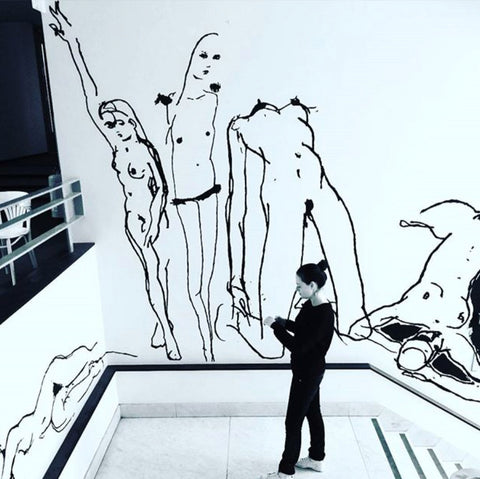 mural in restaurant Baut in Amsterdam 2016. Black lines on white walls showing five female nude figures.