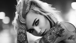 Tattooed and pierced woman