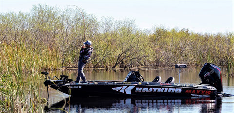 Bass Pro Brent Chapman pulls bass out of heavy cover with KastKing fishing rod.