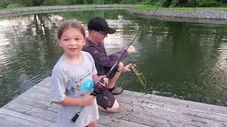 Kids fishing with KastKing spincast reel on a pond dock for bluegills