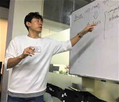 Tate Cui working at drawing board for KastKing product design.