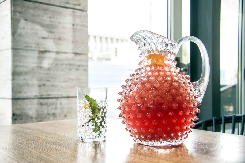 Crystal Hobnail Tumbler alongside matching Jug with a juice inside