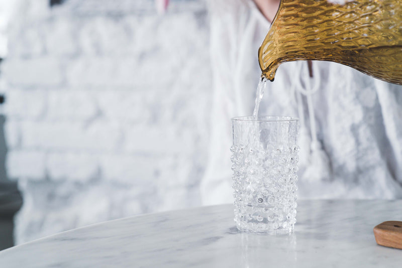 Crystal Hobnail Tumbler with water pouring from jug