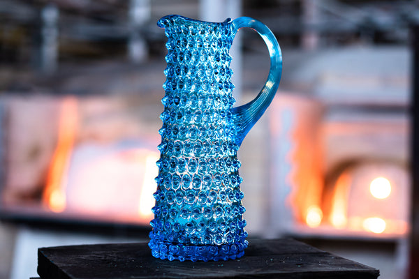 Glass Azure Hobnail Jug standing in the Glass Factory