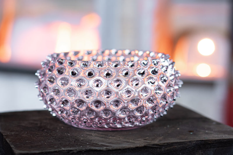 Close-up photo of Lilac Hobnail Bowl in front of glass furnace