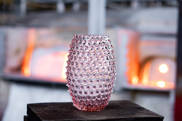 Rosaline Hobnail Egg Vase in front of the glass furnace