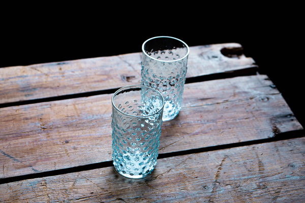 Two Underlay Aquamarine Tumblers on a wooden table