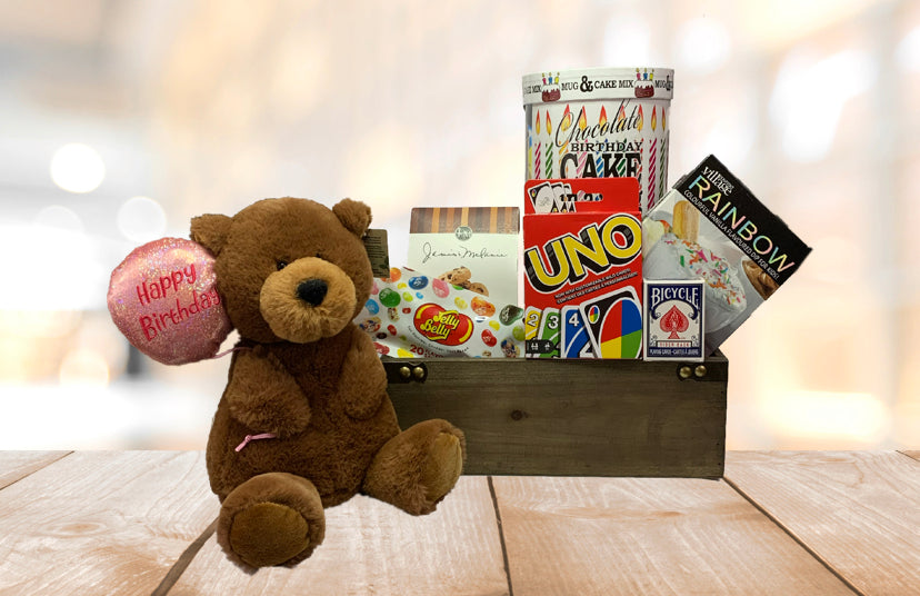 Birthday gift with teddy bear and cookies