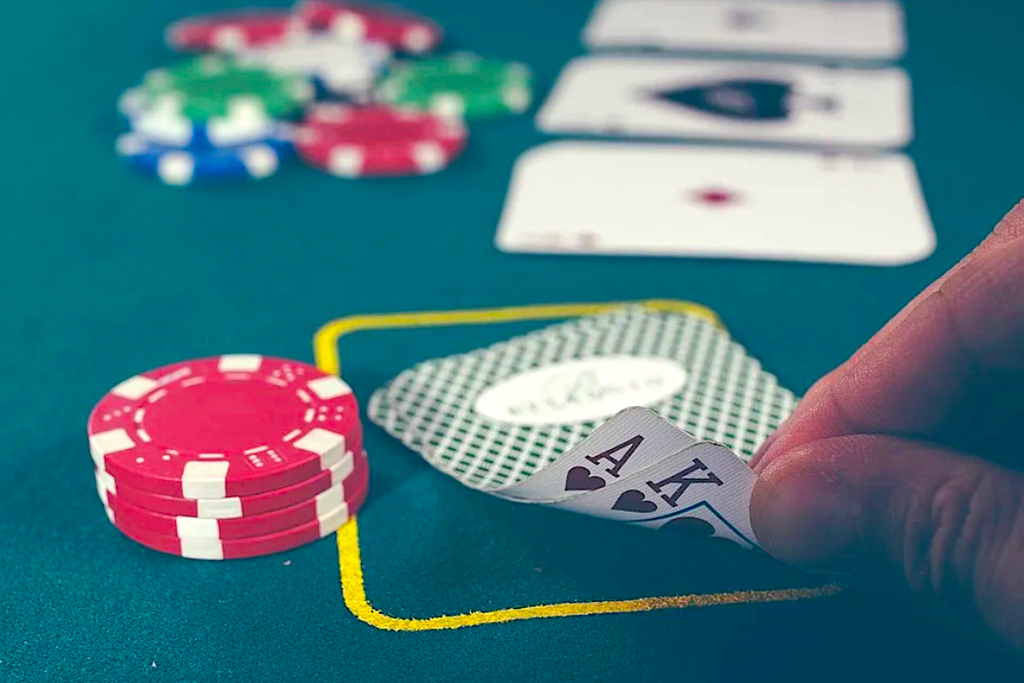 playing_poker_at_poker_table_with_poker_chips