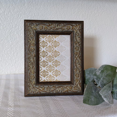 FRAMED CHIC | Delightful carved wood frame and hand-touched gold leaf highlights. Ornate frame. 5x7 picture frame.