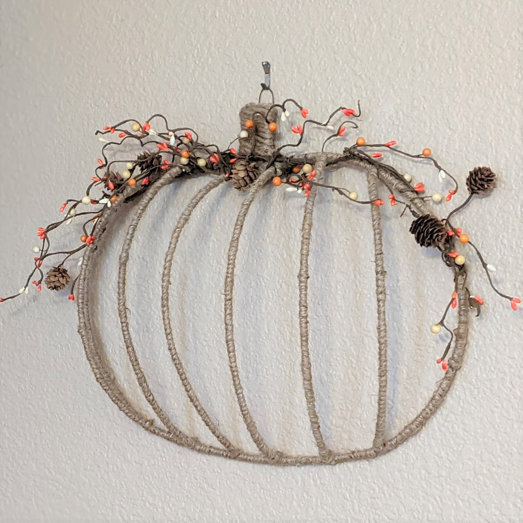 Jute wrapped pumpkin wall decor features pinecones, orange and white berries  | FRAMED CHIC Upcycled home decor