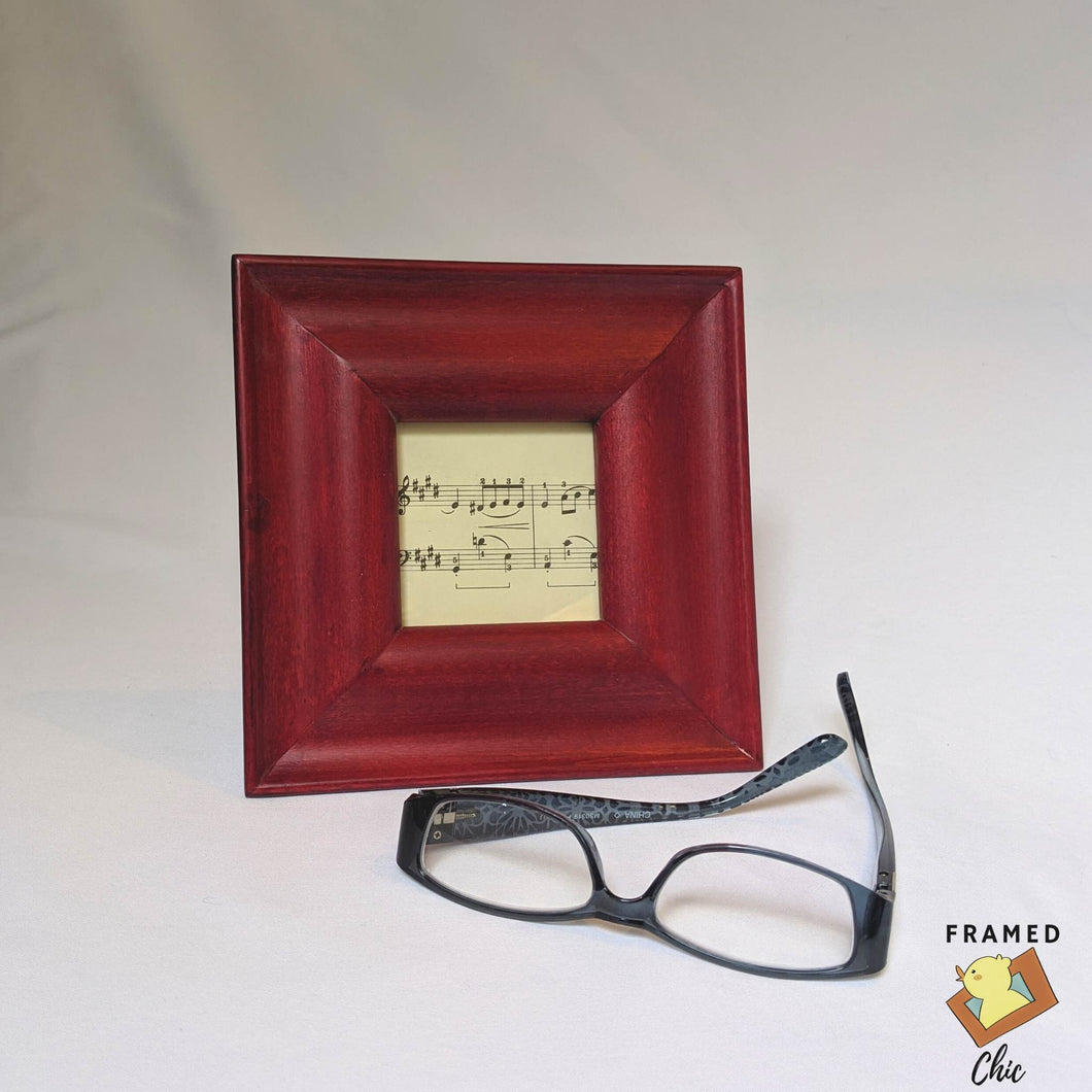 Lovely mahogany red tabletop frame. Check out Framed Chic for your picture frame and home decor needs.