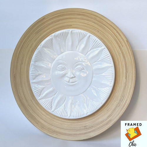 Gorgeous white ceramic and light wood sun wall art piece.