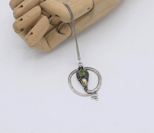 """Silver snake"" 1970s peridot and silver necklace"