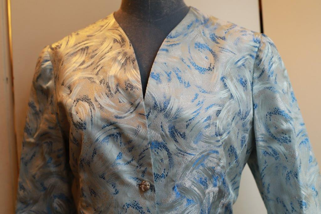 """1930s style jacket"" fitted silk with an abstract pattern."