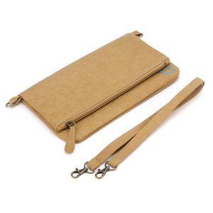 Paper leather clutch purse lying flat with strap.
