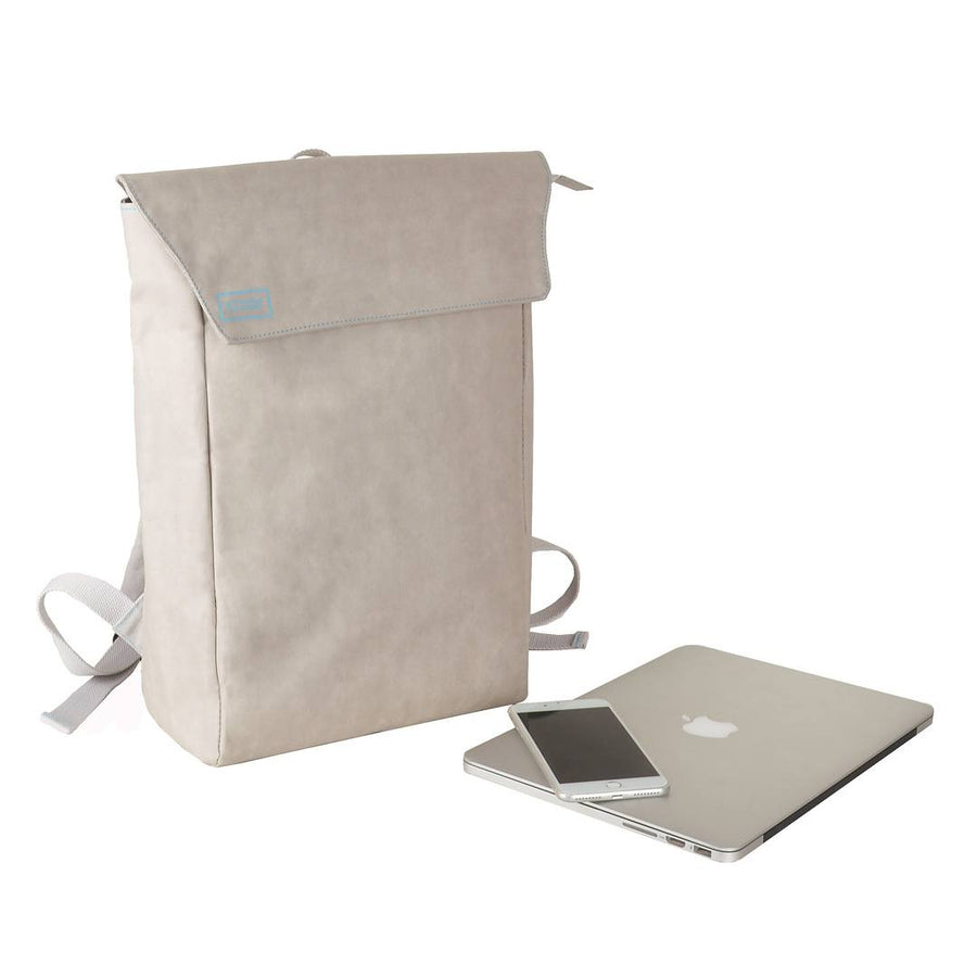Grey Flip-Top paper leather DrawBag angle with MacBook.