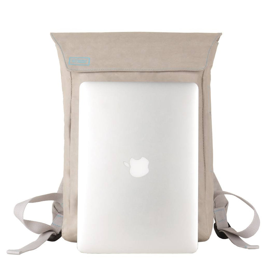 Grey Flip-Top paper leather DrawBag with MacBook in front.