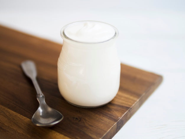 Delicious natural yogurt on a container Free Photo