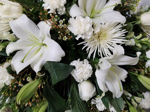 Assorted white flowers arranged with greenery