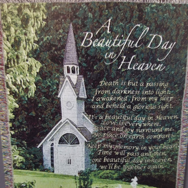 "Afghan with a picture of a church in a forest with the poem next to it that reads, ""A Beautiful Day in Heaven. Death is but a passing from darkness into light. I awakened from my sleep and beheld a glorious sight. It's a beautiful day in Heaven. Love is everywhere. Peace and joy surround me. No place on earth compares. Keep my memory in your heart. Time will pass and then, one beautiful day in heaven, we'll be together again."""