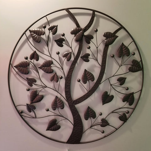 Circular metal wall art, dark bronze in color, abstract tree of life design, full view