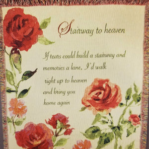 "Close up view. Woven throw with red flower design on ivory background with saying ""Stairway to Heaven. If tears could build a stairway and memories a lane, I'd walk right up to Heaven and bring you home again"""