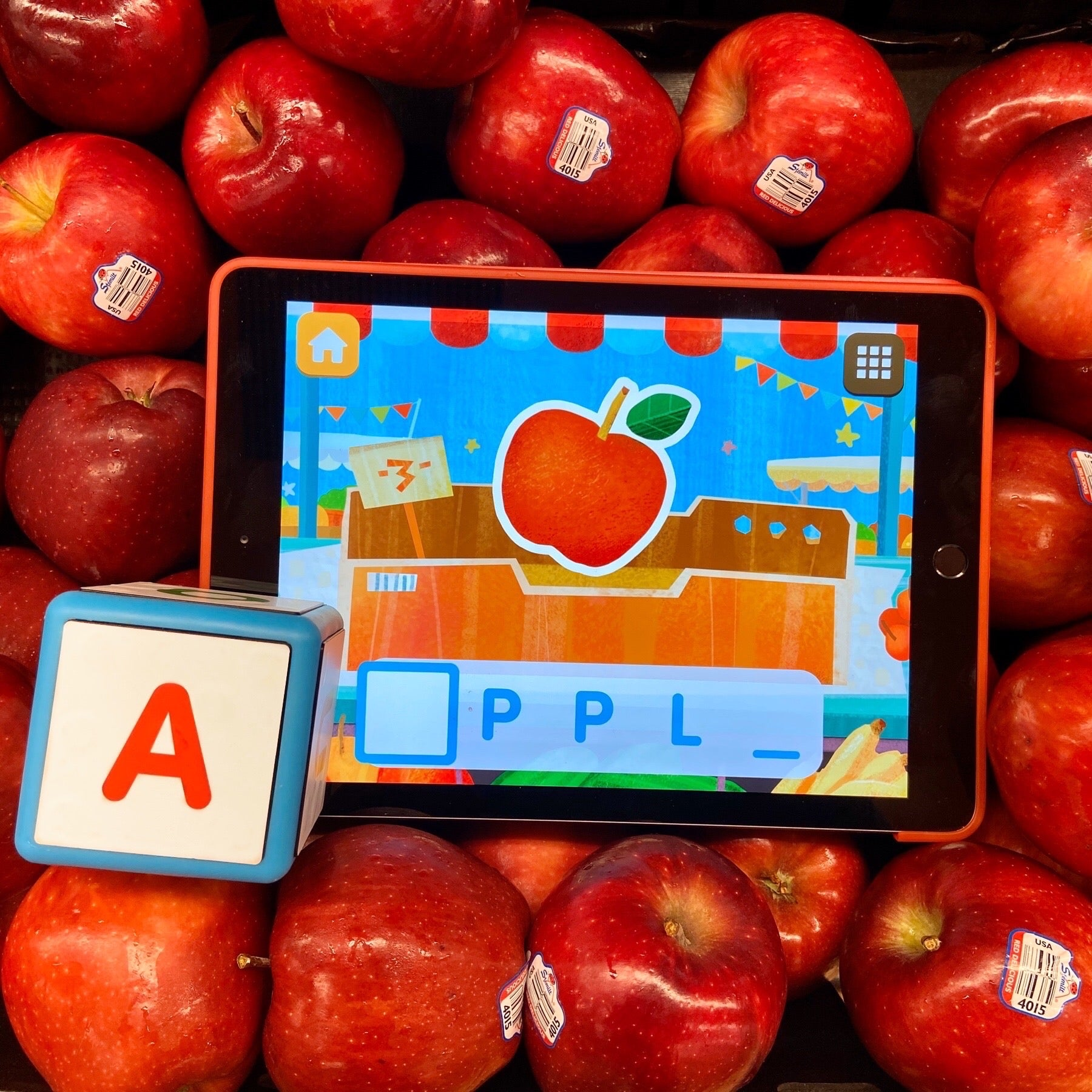 Cookie Kiddle cube and iPad with real apples