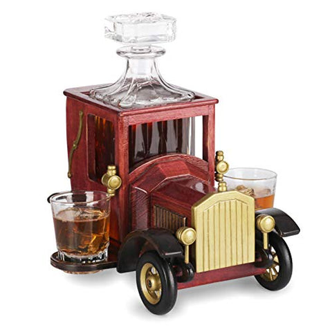 Set of whiskey decanters with crystal glasses and old fashioned car holder