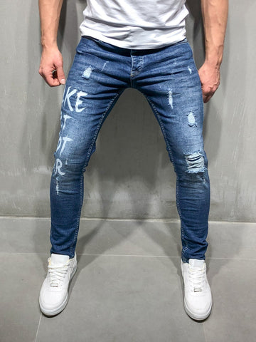 Random Ripped Jeans with Type Print - Zzyzx Road Apparel