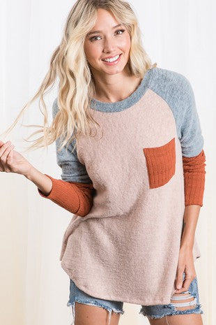 Brushed fabric front pocket contrast long sleeve raglan top.