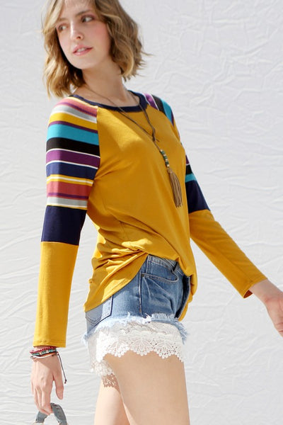Raglan top with contrasting striped sleeves