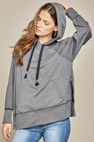 Solid knit pullover with hoodie detail and side zipper detail