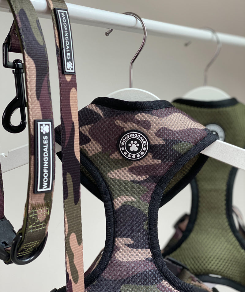 Woofingdales green & brown Camouflage print reversible mesh harness handing next to the reverse khaki side, with matching camo lead and collar too