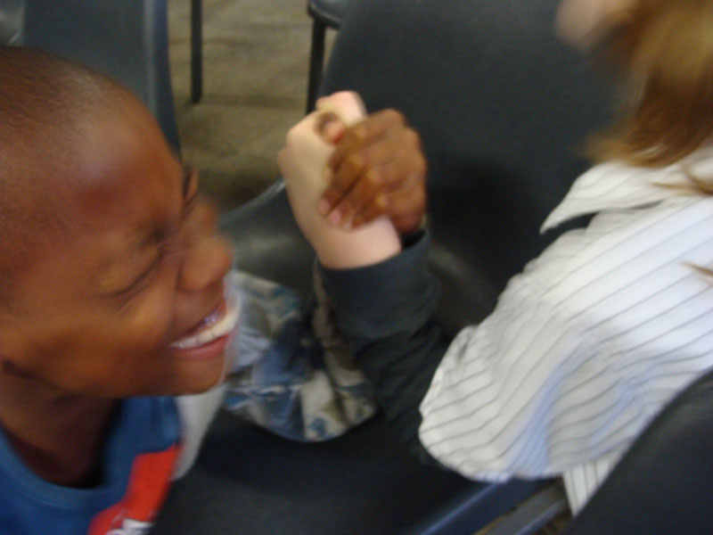 Connor and Ameha arm-wrestling after church