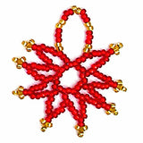 Delicate beaded Christmas star ornaments in red with gold accents from Beaded Hope