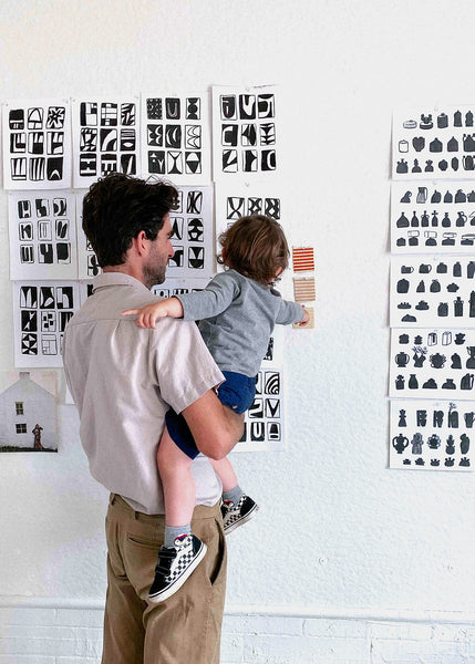 Father and son design meeting.
