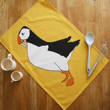 Load image into Gallery viewer, Puffin Tea towel with Yellow background