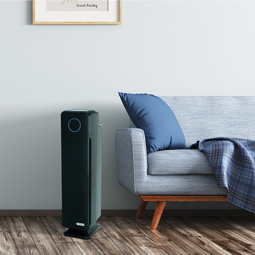 Modern GermGuardian AC5300B Air Purifier in simple living room.
