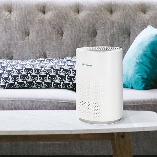 GermGuardian AC4200W on luxurious living room table.