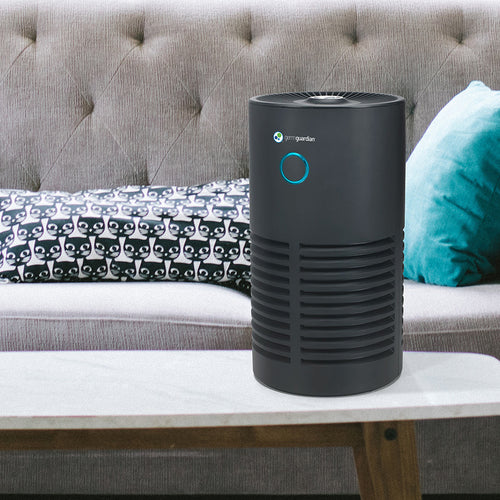 GermGuardian AC4700BDLX Air Purifier in modern and spacious living room.