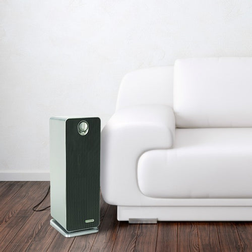 Refurbished RAC4900 Air Purifier next to modern white couch.