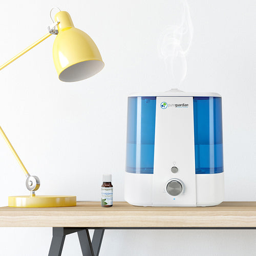 PureGuardian H1175 Ultra-Quiet Humidifier on Desk in Home Office